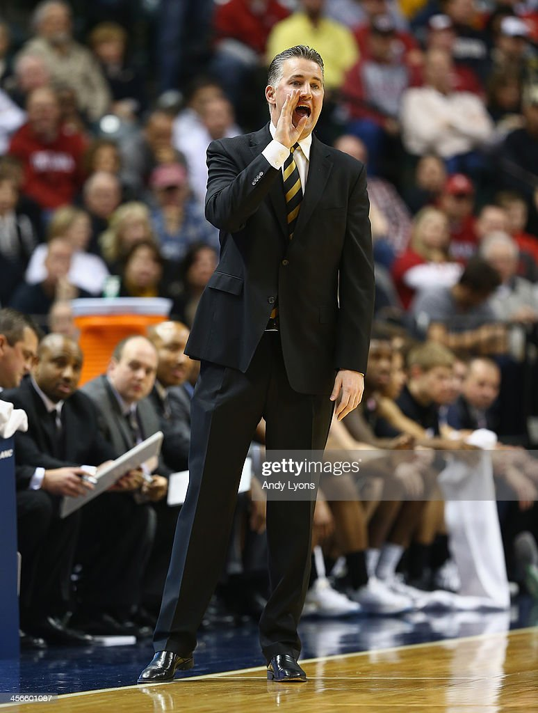 Matt Painter the head coach of the Purdue Boilermakers gives instructions to his team in the game against the Butler Bulldogs during the 2013 Crossroads Classic at Bankers Life Fieldhouse on December 14, 2013 in Indianapolis, Indiana.