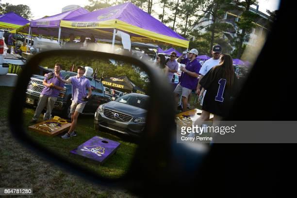Matt Parsons of Goldsboro North Carolina underhands a bean bag next to friend Justin Parker of Kenly North Carolina during a game of cornhole shown...