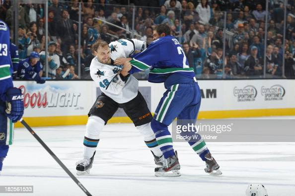 Matt Pelech of the San Jose Sharks mixes it up against Tom Sestito of the Vancouver Canucks during a preseason NHL game at SAP Center on September 24...