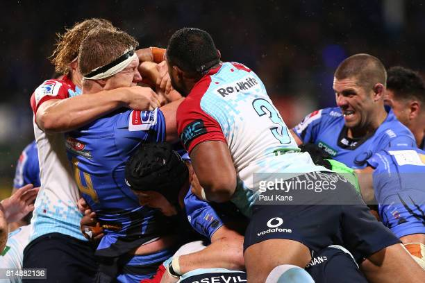Matt Philip of the Force gets tackled by Ned Hanigan and Sekope Kepu of the Waratahs during the round 17 Super Rugby match between the Force and the...