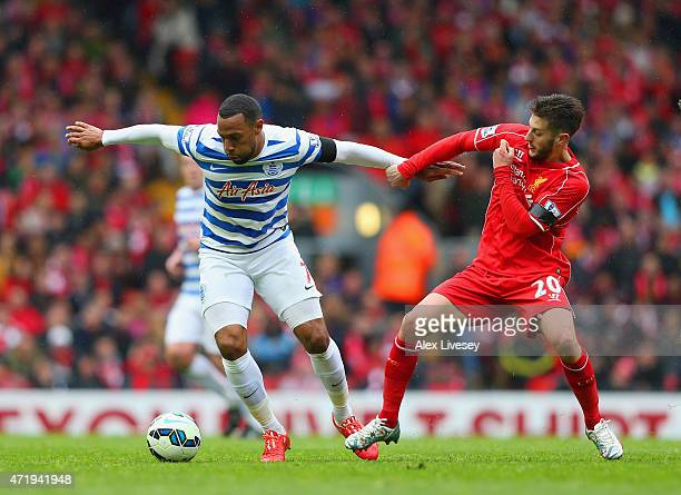 Matt Phillips of QPR and Adam Lallana of Liverpool compete for the ball during the Barclays Premier League match between Liverpool and Queens Park...