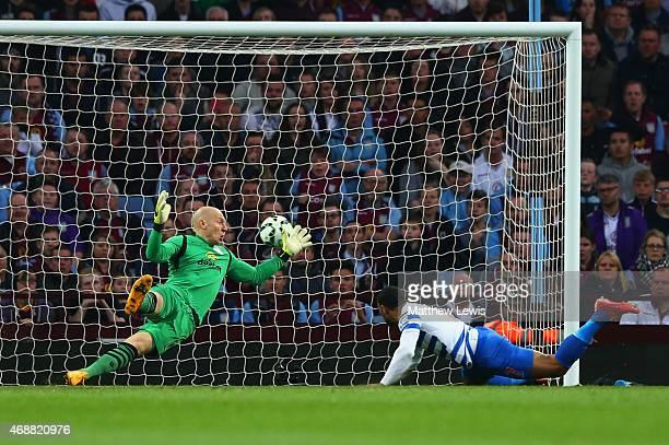Matt Phillips of QPR scores their first goal with a header past goalkeeper Brad Guzan of Aston Villa during the Barclays Premier League match between...