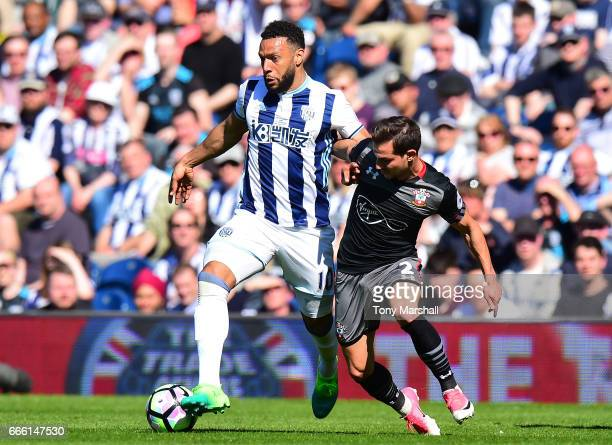 Matt Phillips of West Bromwich Albion and Cedric Soares of Southampton battle for possession during the Premier League match between West Bromwich...