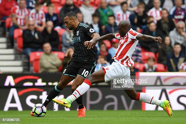 Matt Phillips of West Bromwich Albion attempts to cross the ball while Bruno Martins Indi of Stoke City attempts to block during the Premier League...