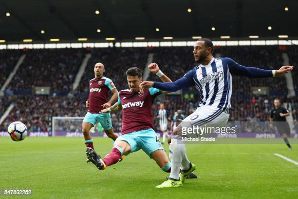 Matt Phillips of West Bromwich Albion crosses as Jose Fonte of West Ham United attempts to block during the Premier League match between West...