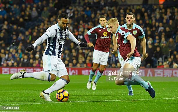 Matt Phillips of West Bromwich Albion shootd past Ben Mee of Burnley as he scores their first goal during the Premier League match between West...