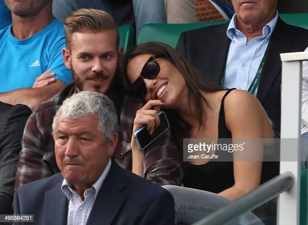 Matt Pokora aka M Pokora and his girlfriend attend Gael Monfils' match on Day 9 of the French Open 2014 held at RolandGarros stadium on June 2 2014...