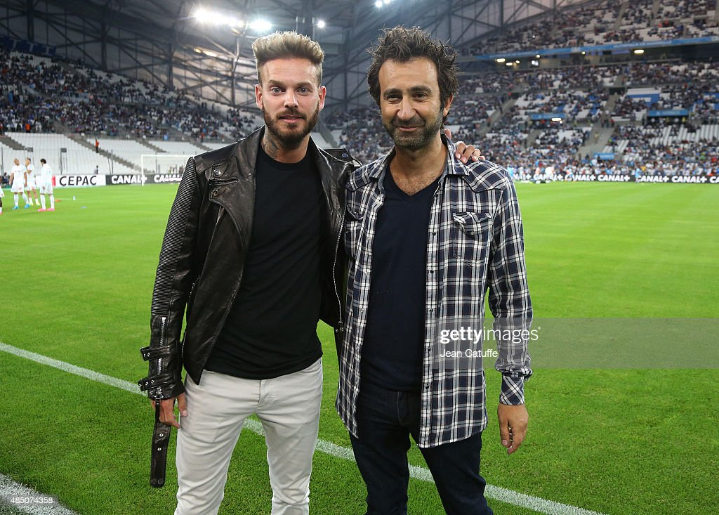 Matt Pokora and Mathieu Madenian attend the French Ligue 1 match between Olympique de Marseille (OM) and Troyes ESTAC at New Stade Velodrome on August 23, 2015 in Marseille, France.