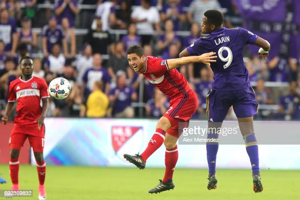 Matt Polster of Chicago Fire and Cyle Larin of Orlando City SC fight for the ball during a MLS soccer match between the Chicago Fire and the Orlando...