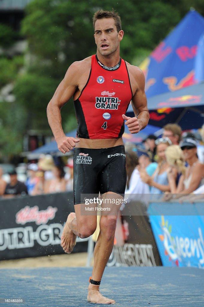 Matt Poole runs the transition during the Noosa Heads round of the 2012-13 Kelloggs Nutri-Grain Ironman Series on February 24, 2013 in Noosa, Australia.