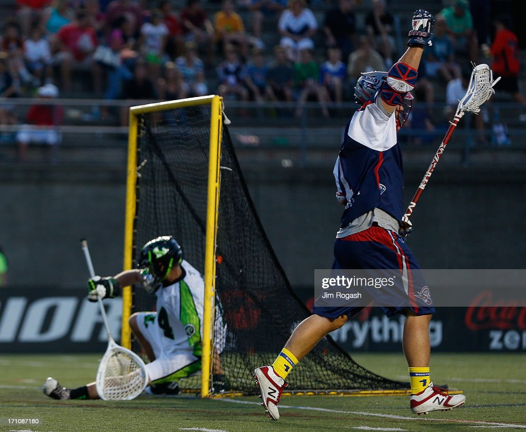 Matt Poskay #7 of the Boston Cannons reacts after he scored on Drew Adams #14 of the New York Lizards in the first half at Harvard Stadium on June 21, 2013 in Boston, Massachusetts.