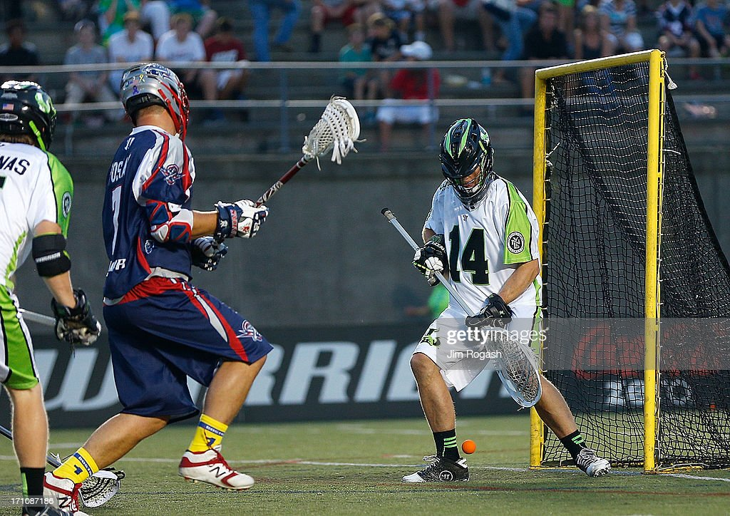 Matt Poskay #7 of the Boston Cannons scores on Drew Adams #14 of the New York Lizards in the first half at Harvard Stadium on June 21, 2013 in Boston, Massachusetts.