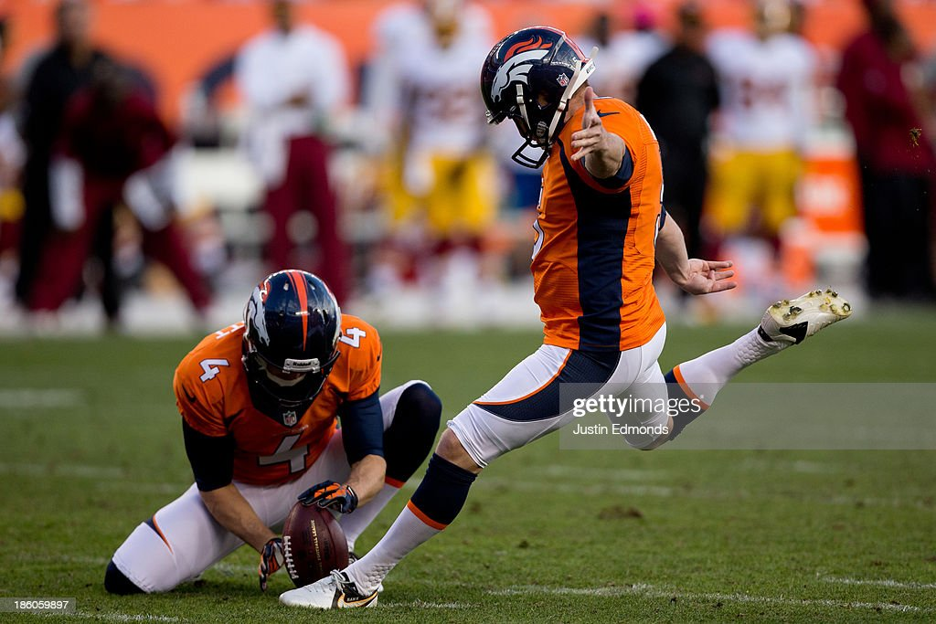 Matt Prater #5 of the Denver Broncos kicks a 19-yard field goal on a hold by Britton Colquitt #4 during the fourth quarter against the Washington Redskins at Sports Authority Field Field at Mile High on October 27, 2013 in Denver, Colorado. The Broncos defeated the Redskins 45-21.