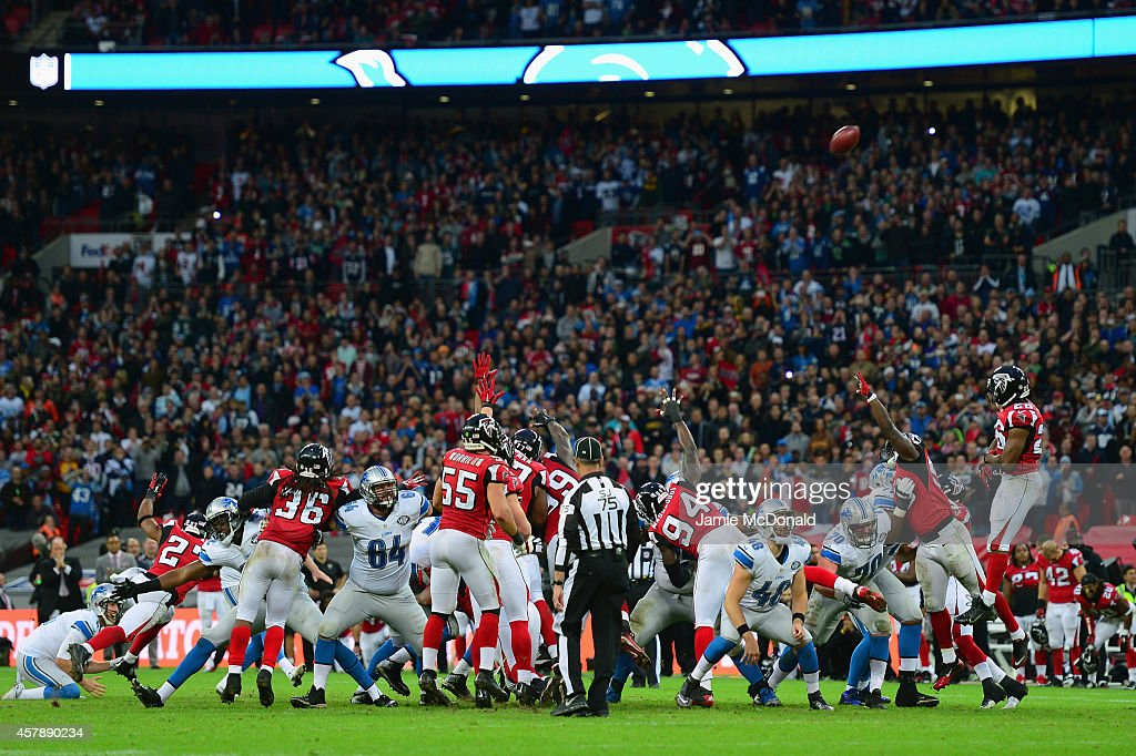<a gi-track='captionPersonalityLinkClicked' href=/galleries/search?phrase=Matt+Prater&family=editorial&specificpeople=4408897 ng-click='$event.stopPropagation()'>Matt Prater</a> #5 of the Detroit Lions kicks a 48 yard field to win the game during the NFL match between Detroit Lions and Atlanta Falcons at Wembley Stadium on October 26, 2014 in London, England.