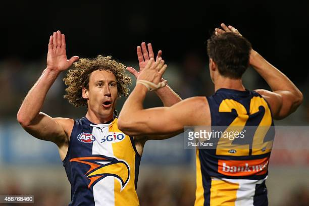 Matt Priddis and Callum Sinclair of the Eagles celebrate a goal during the round 23 AFL match between the West Coast Eagles and the St Kilda Saints...
