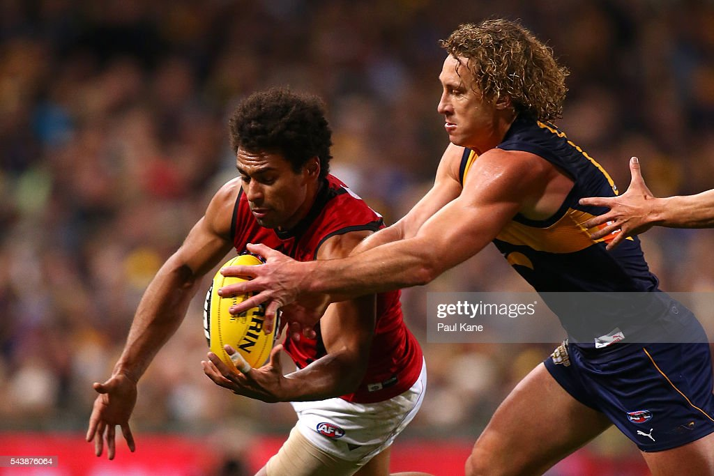 <a gi-track='captionPersonalityLinkClicked' href=/galleries/search?phrase=Matt+Priddis&family=editorial&specificpeople=4155904 ng-click='$event.stopPropagation()'>Matt Priddis</a> of the Eagles and James Gwilt of the Bombers contest for the ball during the round 15 AFL match between the West Coast Eagles and the Essendon Bombers at Domain Stadium on June 30, 2016 in Perth, Australia.