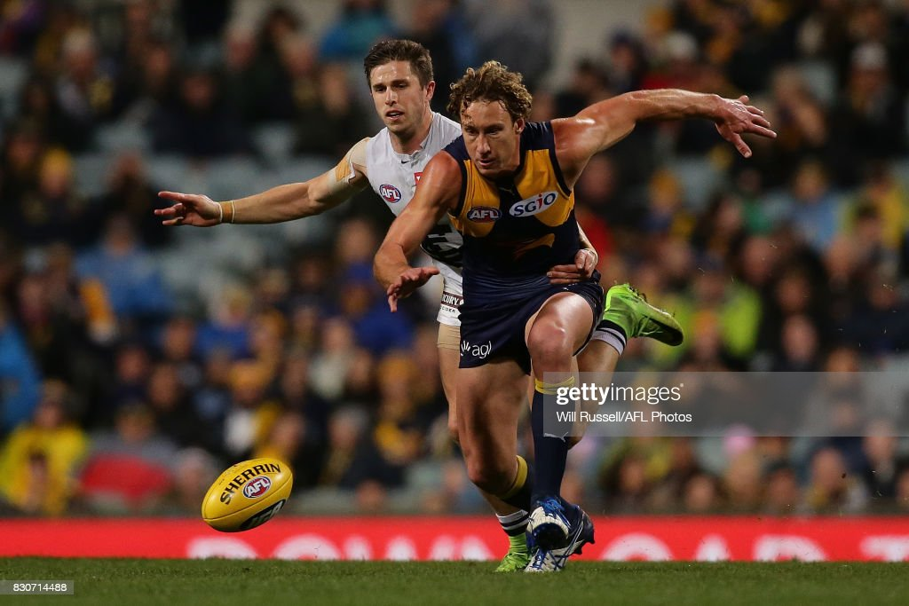Matt Priddis of the Eagles and Marc Murphy of the Blues chase the ball during the round 21 AFL match between the West Coast Eagles and the Carlton Blues at Domain Stadium on August 12, 2017 in Perth, Australia.