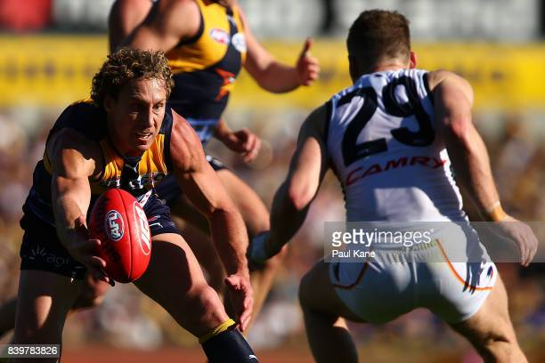 Matt Priddis of the Eagles contests for the ball against Rory Laird of the Crows during the round 23 AFL match between the West Coast Eagles and the...
