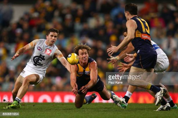 Matt Priddis of the Eagles fires out a hand pass to Luke Shuey during the round 21 AFL match between the West Coast Eagles and the Carlton Blues at...