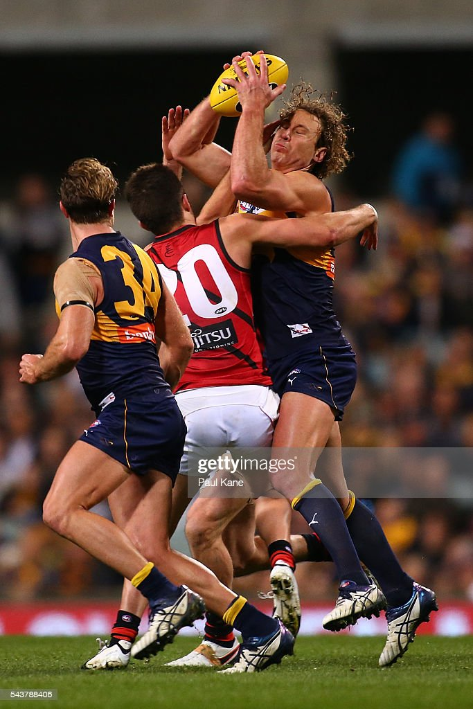<a gi-track='captionPersonalityLinkClicked' href=/galleries/search?phrase=Matt+Priddis&family=editorial&specificpeople=4155904 ng-click='$event.stopPropagation()'>Matt Priddis</a> of the Eagles gathers the ball against Jackson Merrett of the Bombers during the round 15 AFL match between the West Coast Eagles and the Essendon Bombers at Domain Stadium on June 30, 2016 in Perth, Australia.