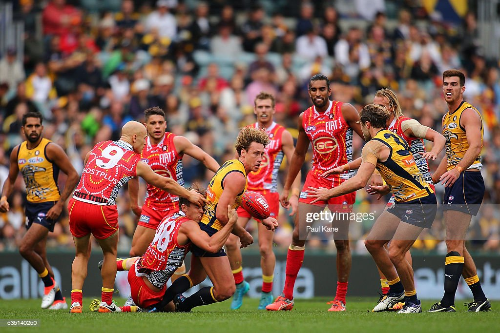 Matt Priddis of the Eagles gets tackled by Seb Tape of the Suns during the round 10 AFL match between the West Coast Eagles and the Gold Coast Suns at Domain Stadium on May 29, 2016 in Perth, Australia.