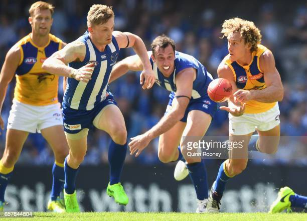 Matt Priddis of the Eagles handballs during the round one AFL match between the North Melbourne Kangaroos and the West Coast Eagles at Etihad Stadium...