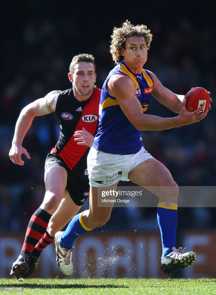 <a gi-track='captionPersonalityLinkClicked' href=/galleries/search?phrase=Matt+Priddis&family=editorial&specificpeople=4155904 ng-click='$event.stopPropagation()'>Matt Priddis</a> (R) of the Eagles runs with the ball away from Heath Hocking of the Bombers during the round 20 AFL match between the Essendon Bombers and the West Coast Eagles at Etihad Stadium on August 11, 2013 in Melbourne, Australia.