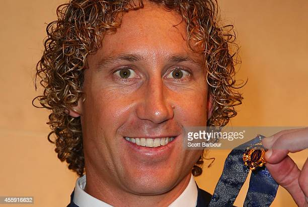Matt Priddis of the West Coast Eagles poses with the 2014 Brownlow Medal at the 2014 Brownlow Medal Dinner at Crown Palladium on September 22 2014 in...