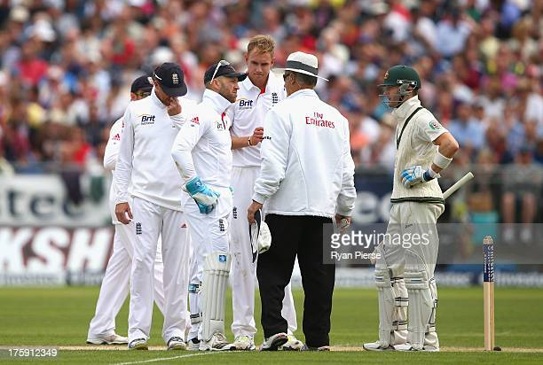 Matt Prior and Stuart Broad of England and Michael Clarke of Australia speak with Umpire Tony Hill after a Chris Rogers of Australia DRS decision...