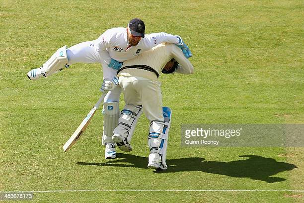 Matt Prior of England and Michael Clarke of Australia run into each other during day one of the Second Ashes Test Match between Australia and England...