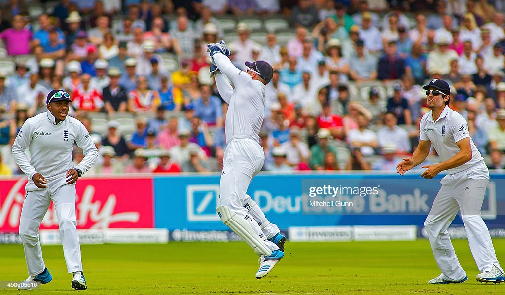 <a gi-track='captionPersonalityLinkClicked' href=/galleries/search?phrase=Matt+Prior+-+Cricket+Player&family=editorial&specificpeople=13652111 ng-click='$event.stopPropagation()'>Matt Prior</a> of England catches the ball to dismiss Kaushal Silva of Sri Lanka as Chris Jordan and <a gi-track='captionPersonalityLinkClicked' href=/galleries/search?phrase=Alastair+Cook+-+Cricket+Player&family=editorial&specificpeople=571475 ng-click='$event.stopPropagation()'>Alastair Cook</a> look on during the Investec 1st Test Match day three between England and Sri Lanka at Lords Cricket Ground, on June 14, 2014 in London, England.