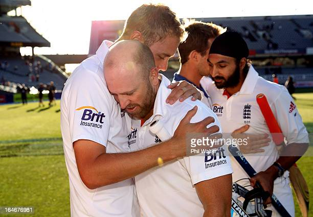 Matt Prior of England is hugged by Stuart Broad as he leaves the field with Monty Panesar at the end of day five of the Third Test match between New...