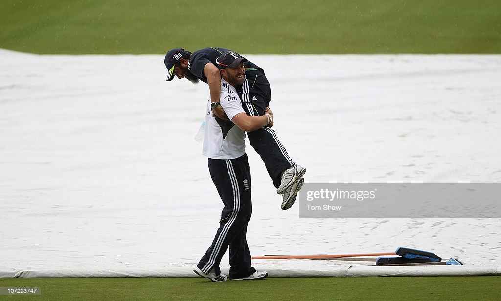 Matt Prior of England lifts up spin bowling coach Mushtaq Ahmed during an England training session at Adelaide Oval on December 1 2010 in Adelaide...