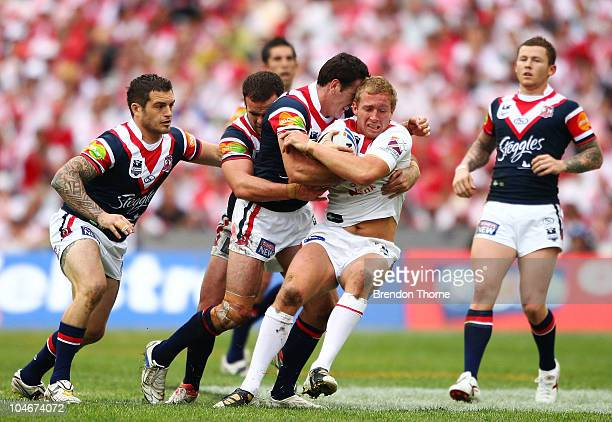 Matt Prior of the Dragons is tackled by the Roosters defence during the NRL Grand Final match between the St George Illawarra Dragons and the Sydney...