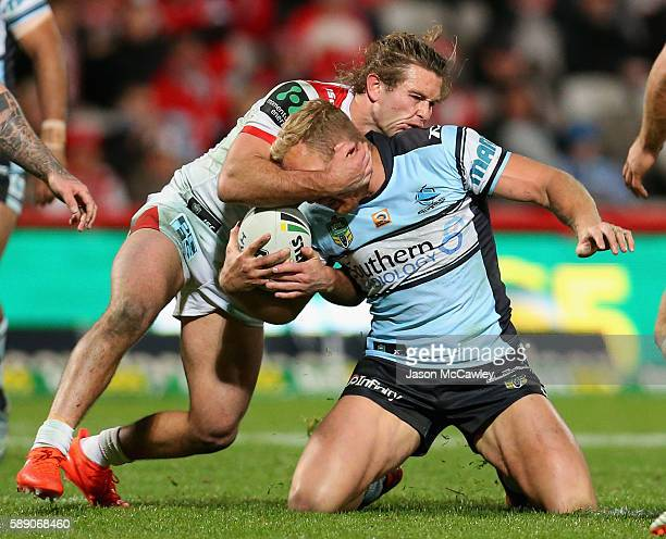 Matt Prior of the Sharks is tackled high during the round 23 NRL match between the St George Illawarra Dragons and the Cronulla Sharks at WIN Jubilee...