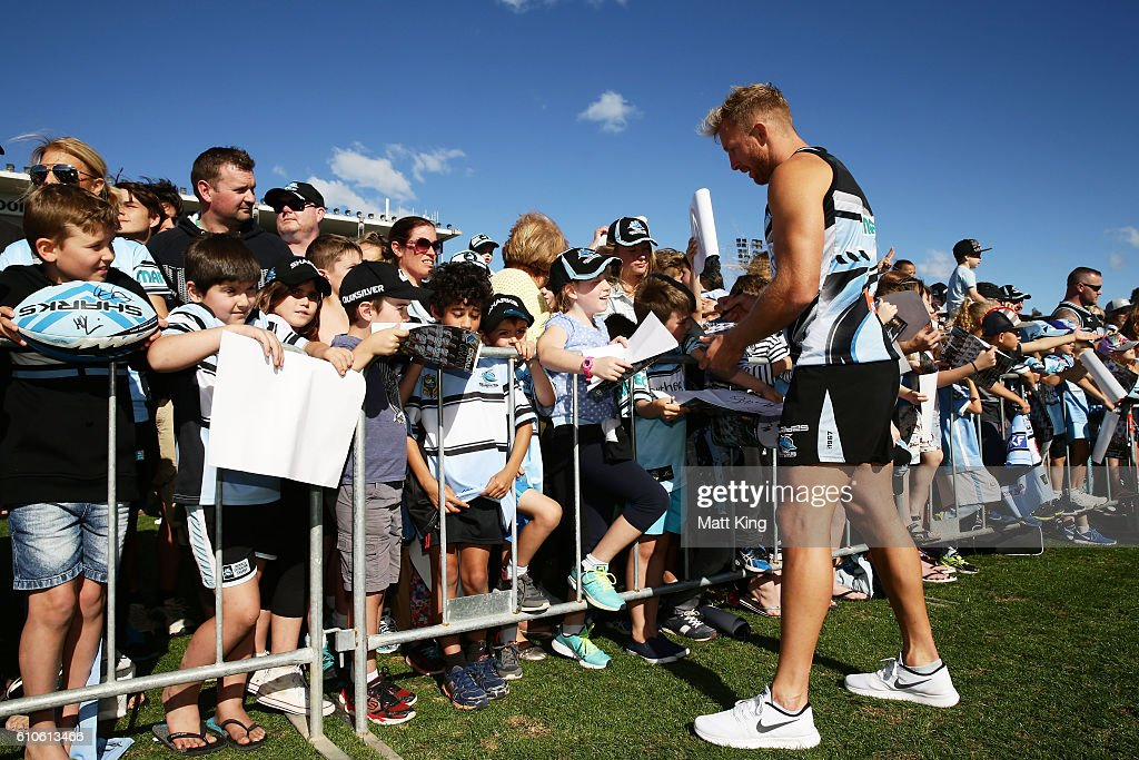 Matt Prior of the Sharks signs autographs for fans during a Cronulla Sharks NRL fan day at Southern Cross Group Stadium on September 27, 2016 in Sydney, Australia.