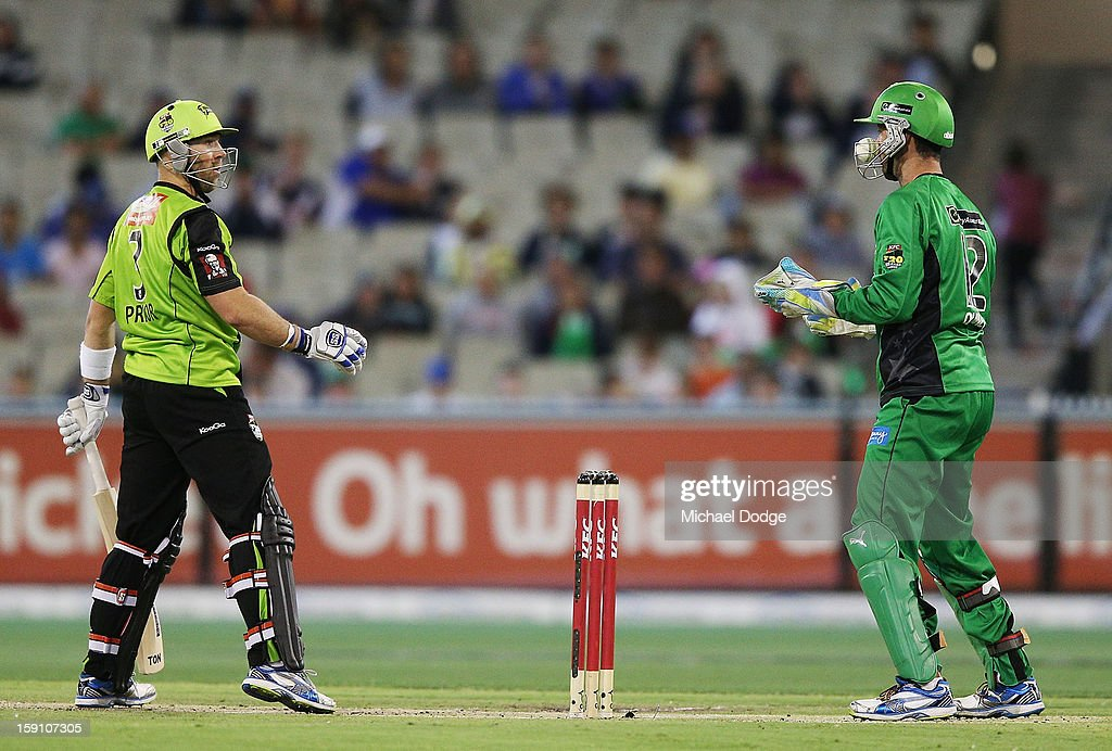 <a gi-track='captionPersonalityLinkClicked' href=/galleries/search?phrase=Matt+Prior+-+Cricket+Player&family=editorial&specificpeople=13652111 ng-click='$event.stopPropagation()'>Matt Prior</a> of the Sydney Thunder reacts as keeper Rob Quiney the Melbourne Stars finds the ball under the grill of his helmet during the Big Bash League match between the Melbourne Stars and the Sydney Thunder at Melbourne Cricket Ground on January 8, 2013 in Melbourne, Australia.
