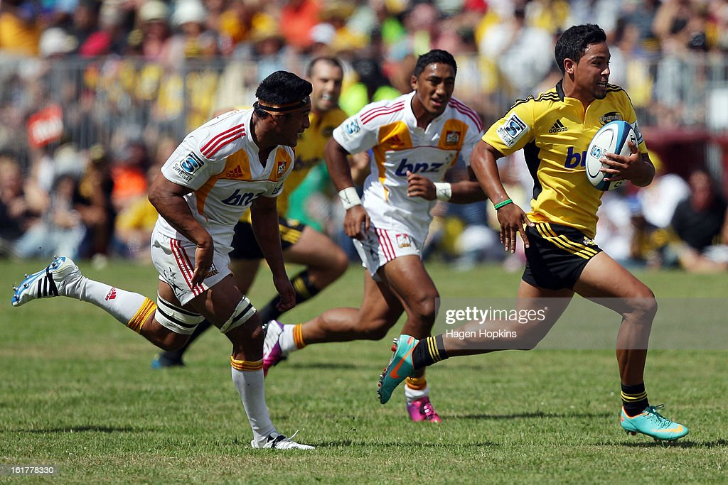 Matt Proctor of the Hurricanes is chased by Tanerau Latimer of the Chiefs during the Super Rugby trial match between the Hurricanes and the Chiefs at Mangatainoka RFC on February 16, 2013 in Mangatainoka, New Zealand.