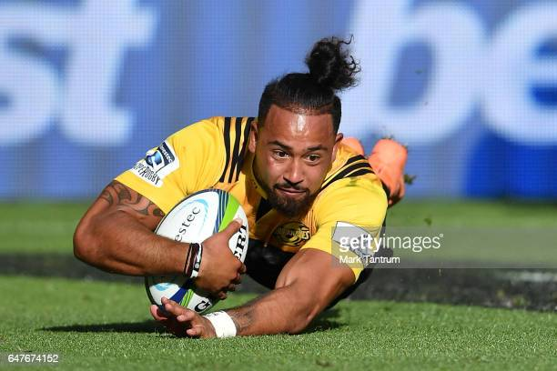 Matt Proctor of the Hurricanes scores a try during the round two Super Rugby match between the Hurricanes and the Rebels at Westpac Stadium on March...
