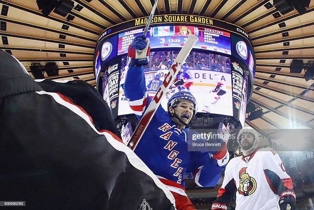 Matt Puempel #12 of the New York Rangers celebrates the game winning goal by h223@ against the Ottawa Senators at Madison Square Garden on December 27, 2016 in New York City. The Rangers defeated the Senators 4-3.