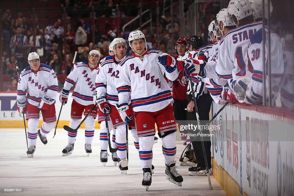 Matt Puempel #12 of the New York Rangers celebrates with teammates on the bench after scoring a power play goal against the Arizona Coyotes during the first period of the NHL game at Gila River Arena on December 29, 2016 in Glendale, Arizona.