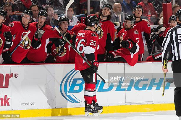 Matt Puempel of the Ottawa Senators celebrates a goal with teammates on the bench in the second period during an NHL game against the Detroit Red...