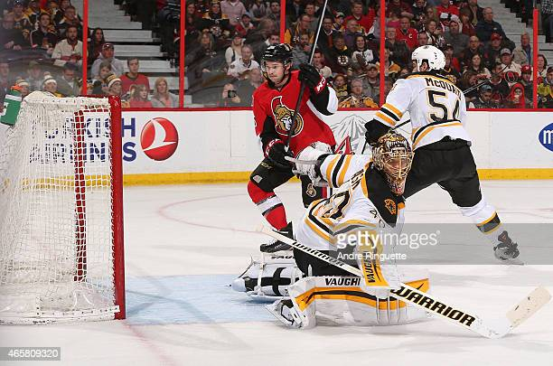 Matt Puempel of the Ottawa Senators positions himself for a rebound that would lead to hist first career NHL goal against Tuukka Rask of the Boston...