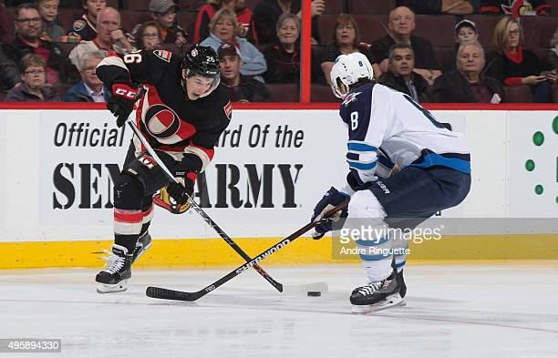 Matt Puempel of the Ottawa Senators stickhandles the puck against Jacob Trouba of the Winnipeg Jets at Canadian Tire Centre on November 5 2015 in...