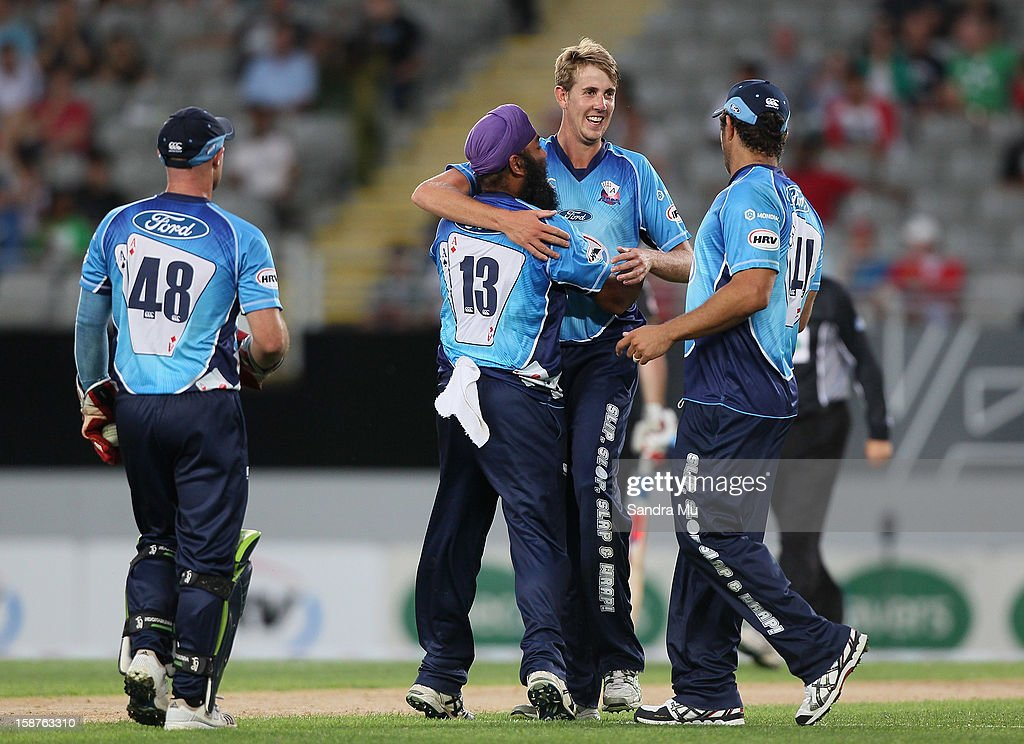 Matt Quinn of Auckland celebrates bowling out Jesse Ryder of Wellington during the HRV Cup Twenty20 match between the Auckland Aces and Wellington Firebirds at Eden Park on December 28, 2012 in Auckland, New Zealand.