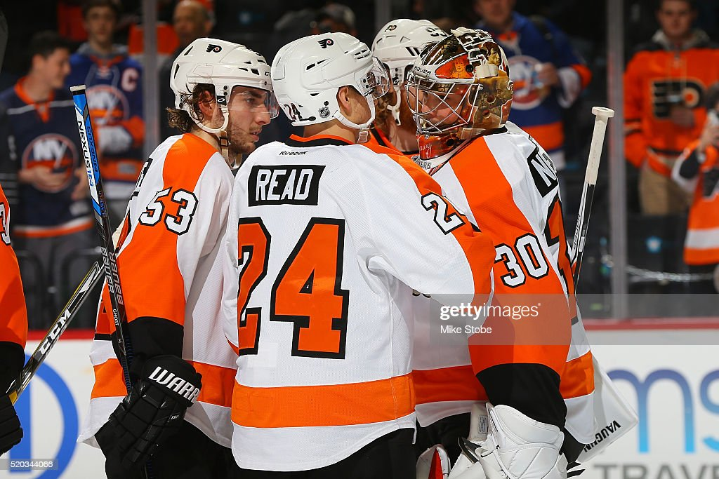 Matt Read abd Michal Neuvirth of the Philadelphia Flyers celebrate their win over the New York Islanders at the Barclays Center on April 10 2016 in...