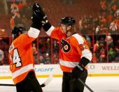Matt Read and Jakub Voracek of the Philadelphia Flyers celebrate the win after the game at Wells Fargo Center on March 5 2014 in Philadelphia...