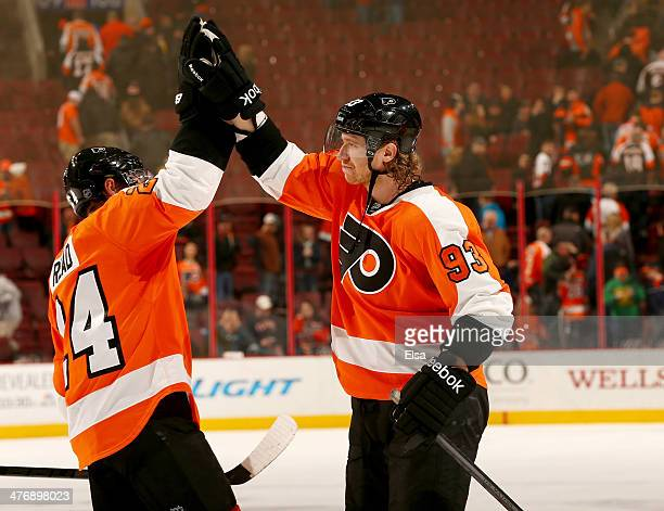 Matt Read and Jakub Voracek of the Philadelphia Flyers celebrate the win after the game at Wells Fargo Center on March 5 2014 in Philadelphia...