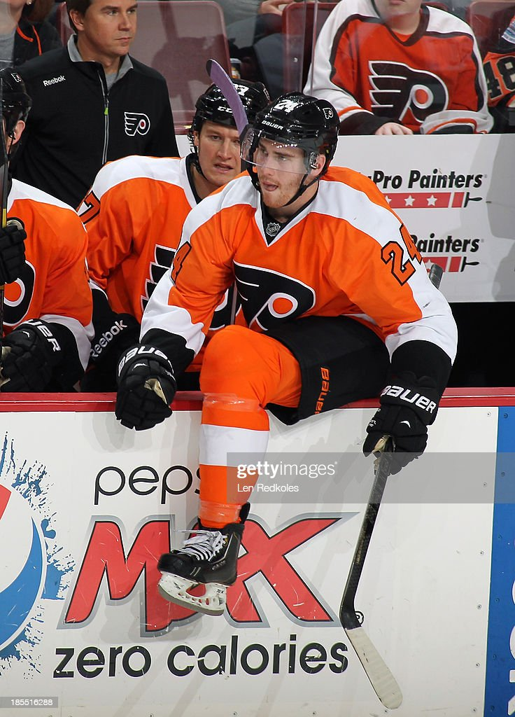 Matt Read and Jay Rosehill of the Philadelphia Flyers look on from the bench against the Vancouver Canucks on October 15 2013 at the Wells Fargo...