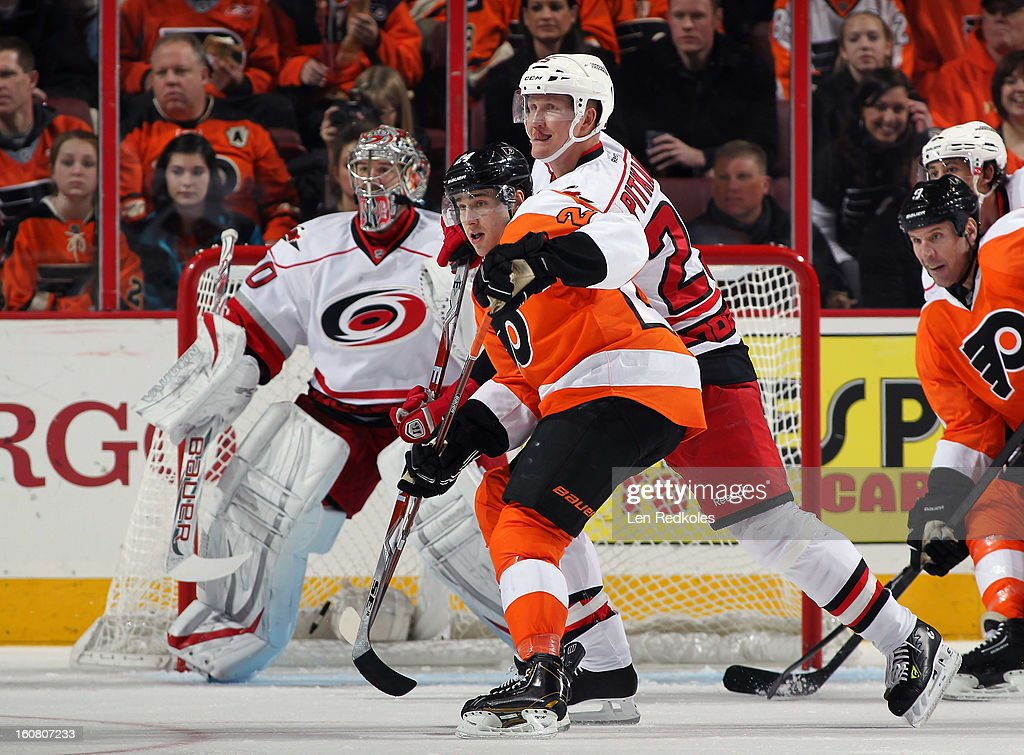 Matt Read #24 and Mike Knuble #9 of the Philadelphia Flyers skate in front of Joni Pitkanen #25 and Cam Ward #30 of the Carolina Hurricanes on February 2, 2013 at the Wells Fargo Center in Philadelphia, Pennsylvania.